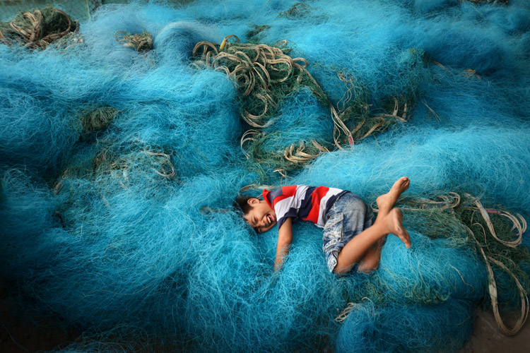 Playing in a Sea of Fishing Nets - Playing in a Sea of Fishing Nets