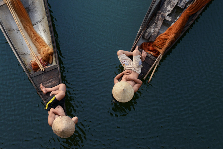 fishermen resting on Boats - Putting the Fine Art into Travel Photography