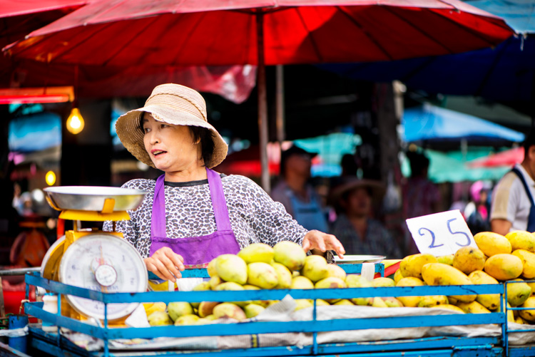 Thai woman selling mangos at the fresh market in Chiang Mai - Slow Down and Take Your Time – Don't Rush Your Photography