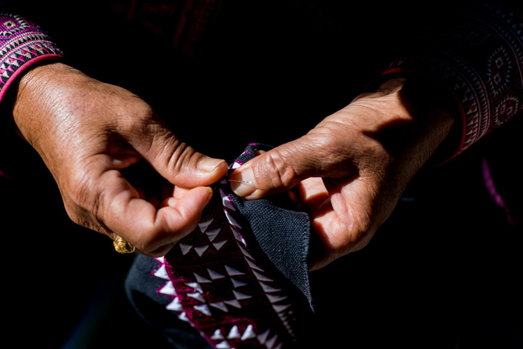 Close up of a Hmong woman hand sewing - Tips for Learning How to See the Light and Take Better Photos