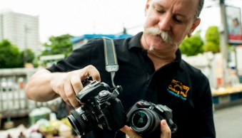 Man with two cameras teaches photography in Chiang Mai, Thailand