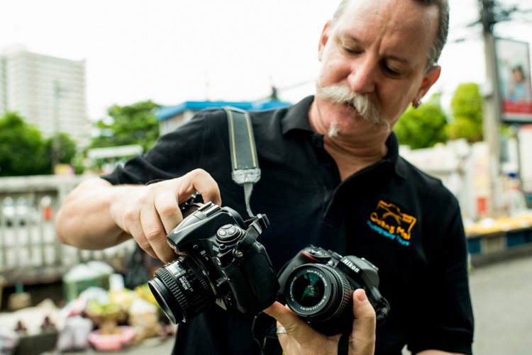 Man with two cameras teaches photography - first digital camera