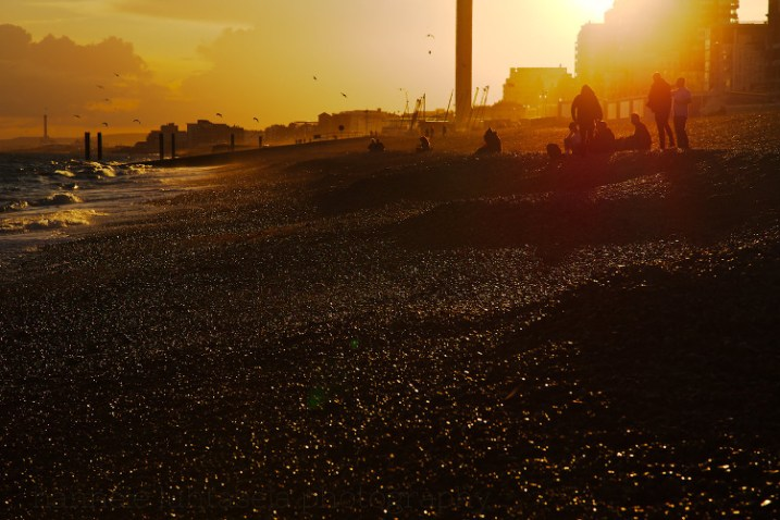 Silhouettes at sunset on the beach in Brighton, England. - Consent in Photography – What to Think About When Photographing People