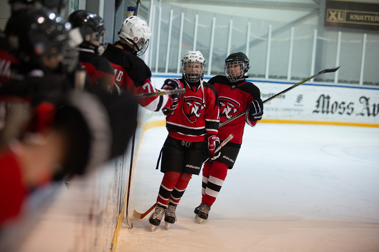 An ice hockey image that is nearly ruined by poor lighting and color casts - Tips for Editing Hockey Photos in Lightroom