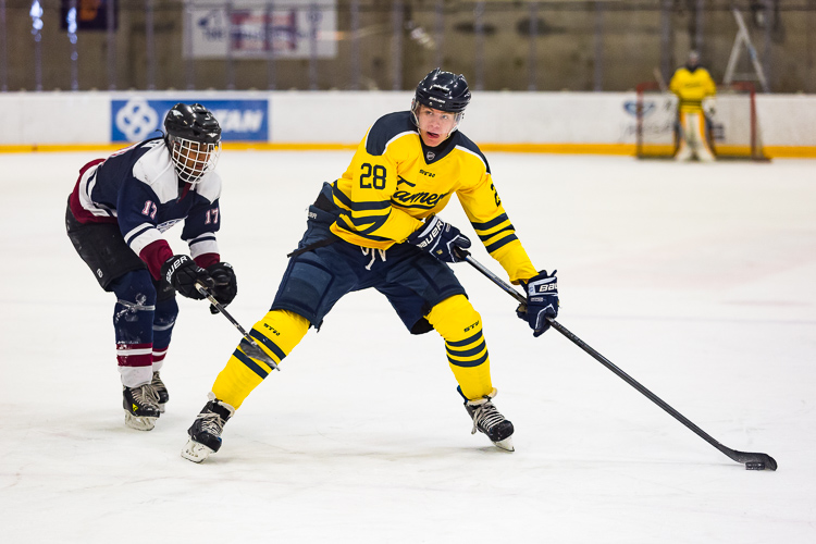 A hockey player deeking around a defender - Tips for Editing Hockey Photos in Lightroom