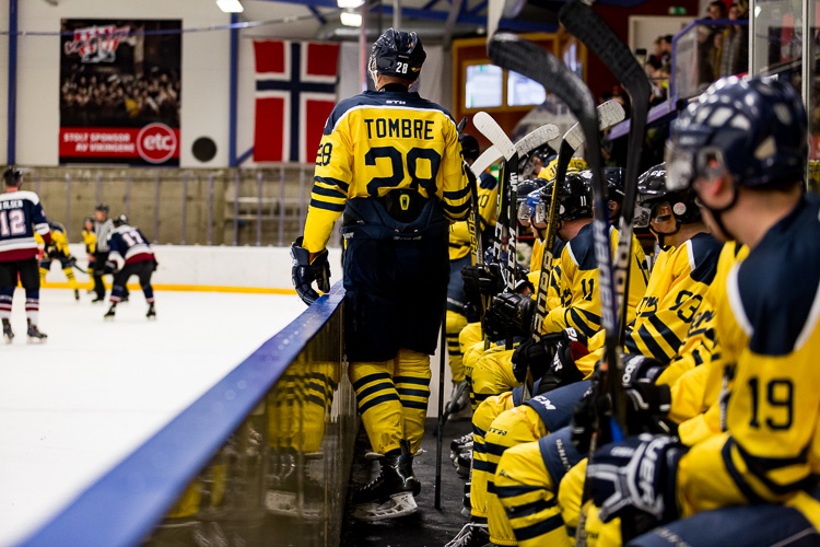 A hockey player on the bench, with a pinch of clarity applied - Tips for Editing Hockey Photos in Lightroom