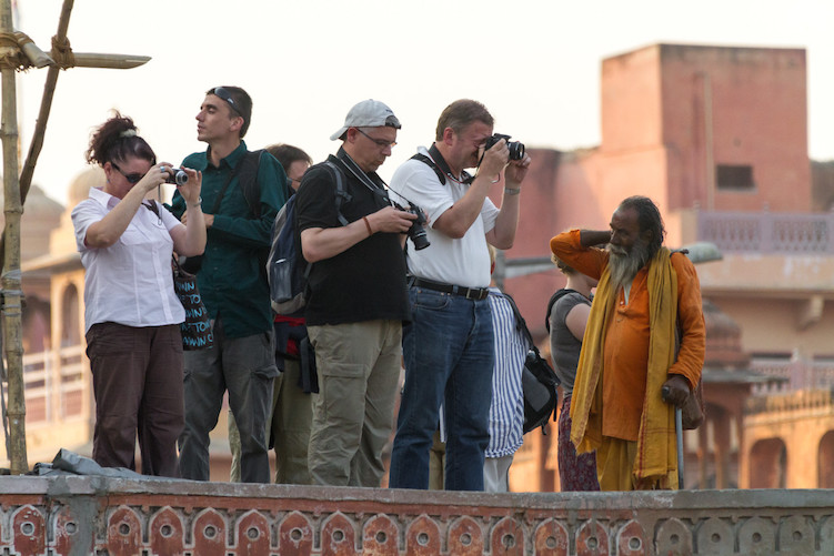 group of photographers shooting - What Happens When You Put Your Camera Down