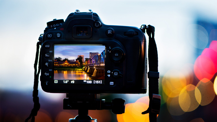 Back of a DSLR camera at dusk - 4 Tips to Help You Love Using Manual Mode