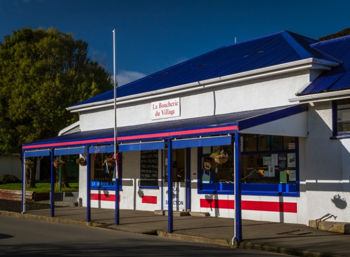 Image: Akaroa embraces its French history with red/white/blue featuring strongly, and many places an...