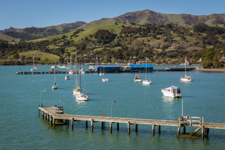 How to do Visual Storytelling with Photos - Akaroa harbour in NZ with boats and a hill