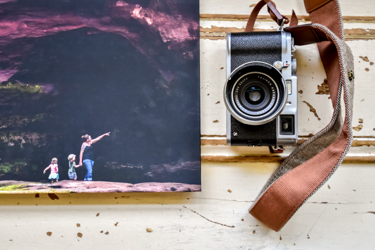 A photobook and a camera - How to Photograph Your Family Vacation