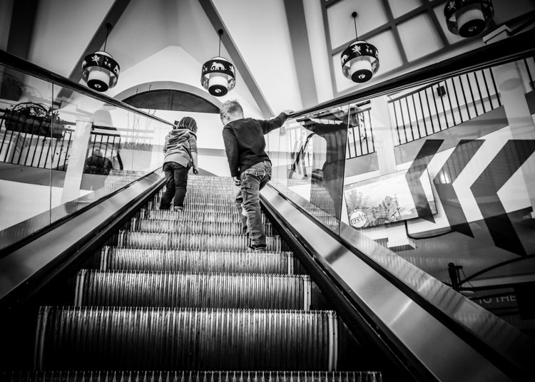Kids riding an escalator - How to Photograph Your Family Vacation