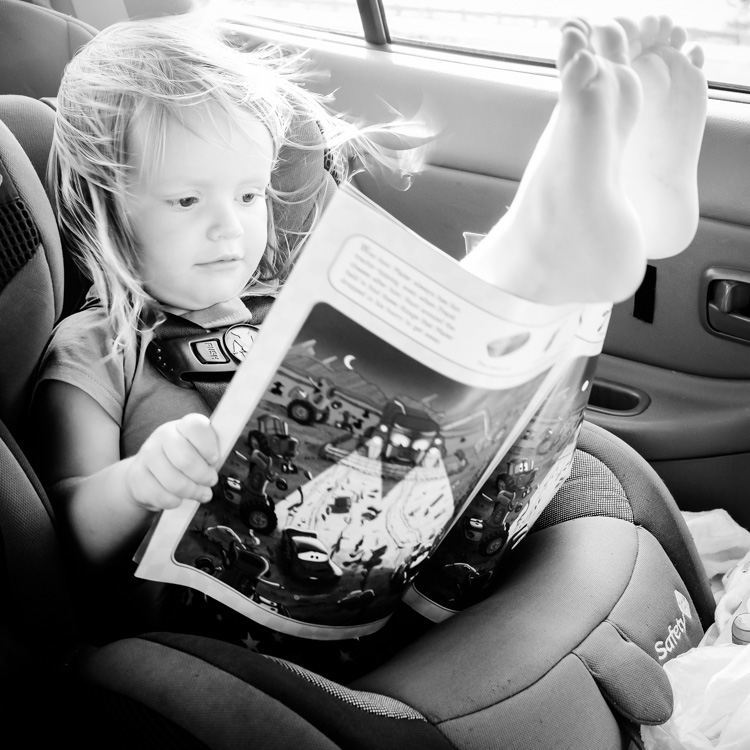 Little girl happy in the car. How to Photograph Your Family Vacation