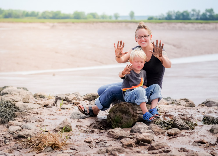 A mom and boy playing in the mud. How to Photograph Your Family Vacation