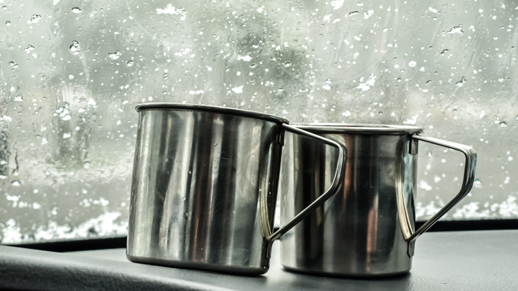 Mugs of hot chocolate on the dashboard. - How to Photograph Your Family Vacation