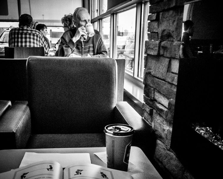 Portrait in a coffee shop - How Conquer Your Fear of People as a Photographer