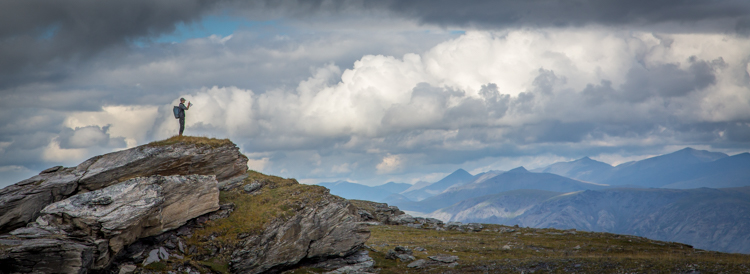 man on a hilltop - Tips for Shooting Landscapes With a Telephoto Lens