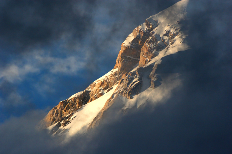 sunlight on part of a rocky mountain cliff - Tips for Shooting Landscapes With a Telephoto Lens