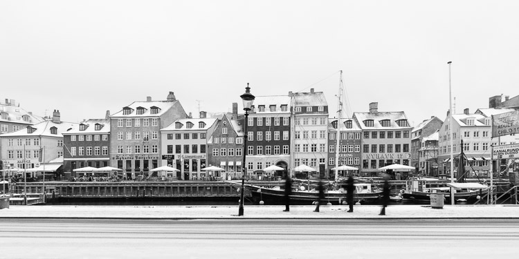 b/w photo of 4 people walking in a city - What Makes Great Photos? 5 Factors That Can Take Your Images From Good to Great