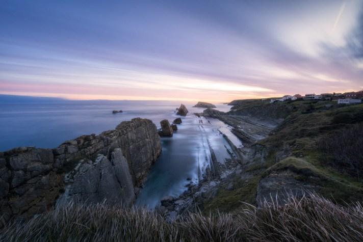 在沿海场面的日落 - 与风景摄影的不同的快门速度一起使用
