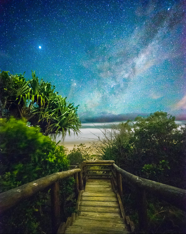 path to the ocean with Milky Way in the night sky - How to Reduce Digital Noise in Astrophotography Using Exposure Stacking