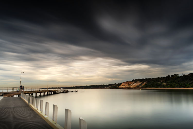 dock with blurry clouds - How Much is an Image Worth? Tips for Pricing Your Photography