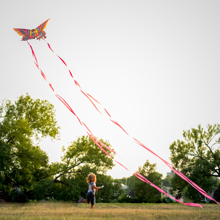 A kid flying a kite.