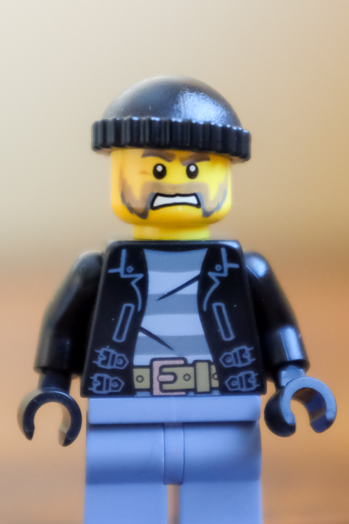 A Lego man with a simple background.