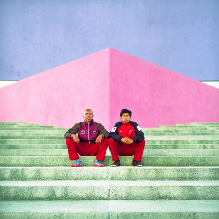 two guys sitting on steps in red pants - 10 Things You Can Learn About Photography from Elliott Erwitt