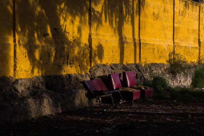 10 Things You Can Learn About Photography from Elliott Erwitt - chairs on the street and a yellow wall