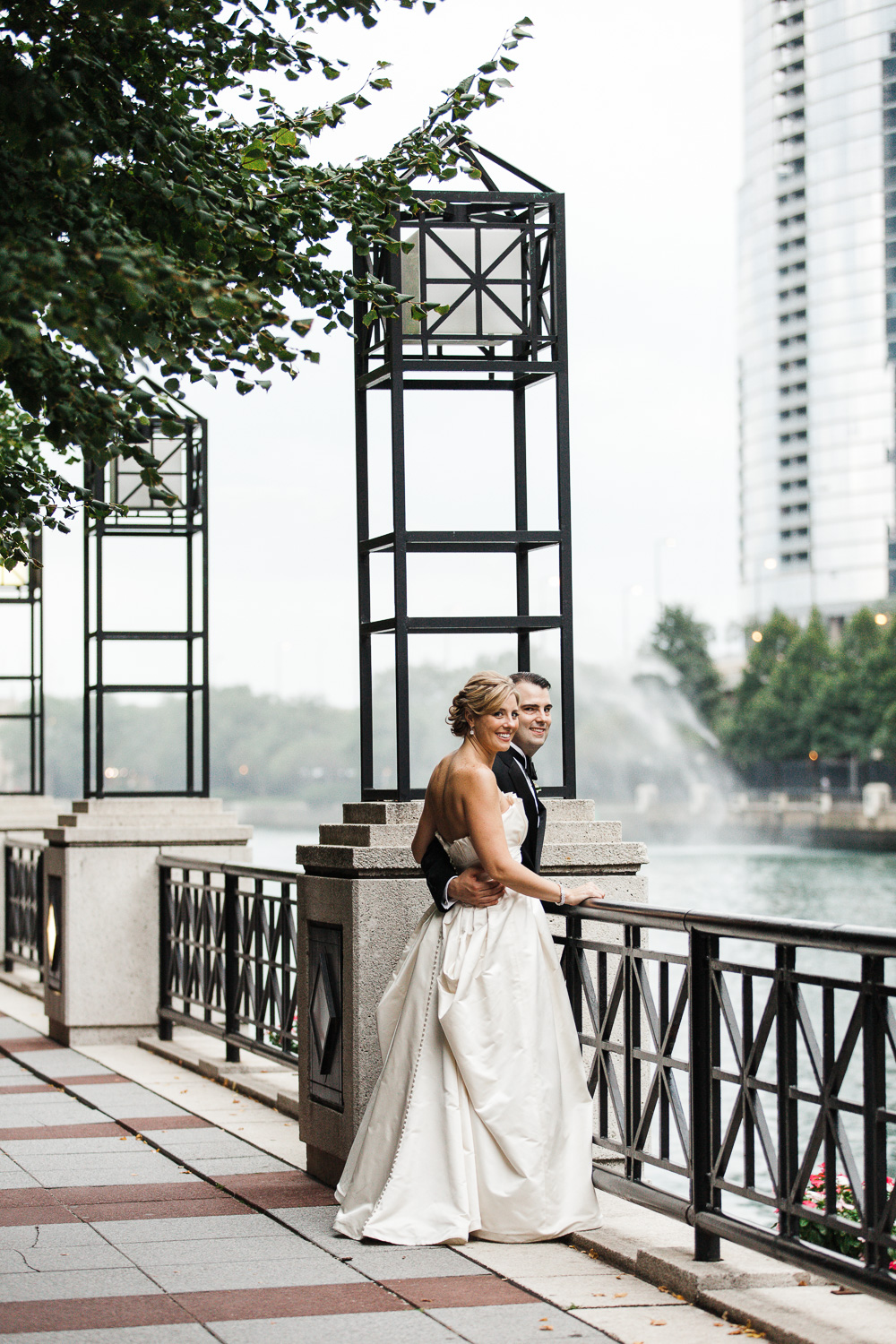 Wedding couple against Chicago riverwalk background