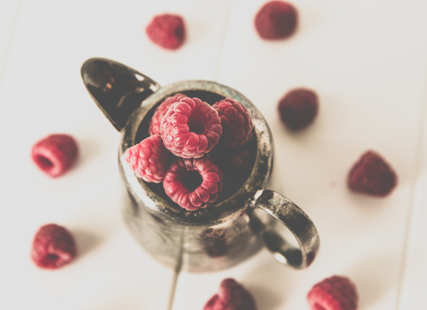 How Aesthetic Differs From Photographic Style And Why it Matters - raspberries in a pitcher