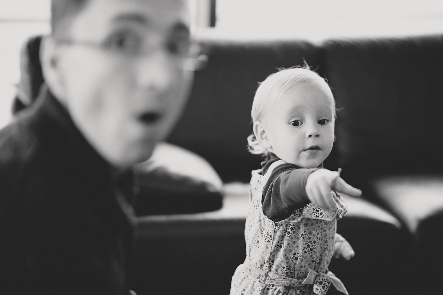 b/w candid of a child pointing - 5 Tips for Doing Lifestyle Photo Sessions