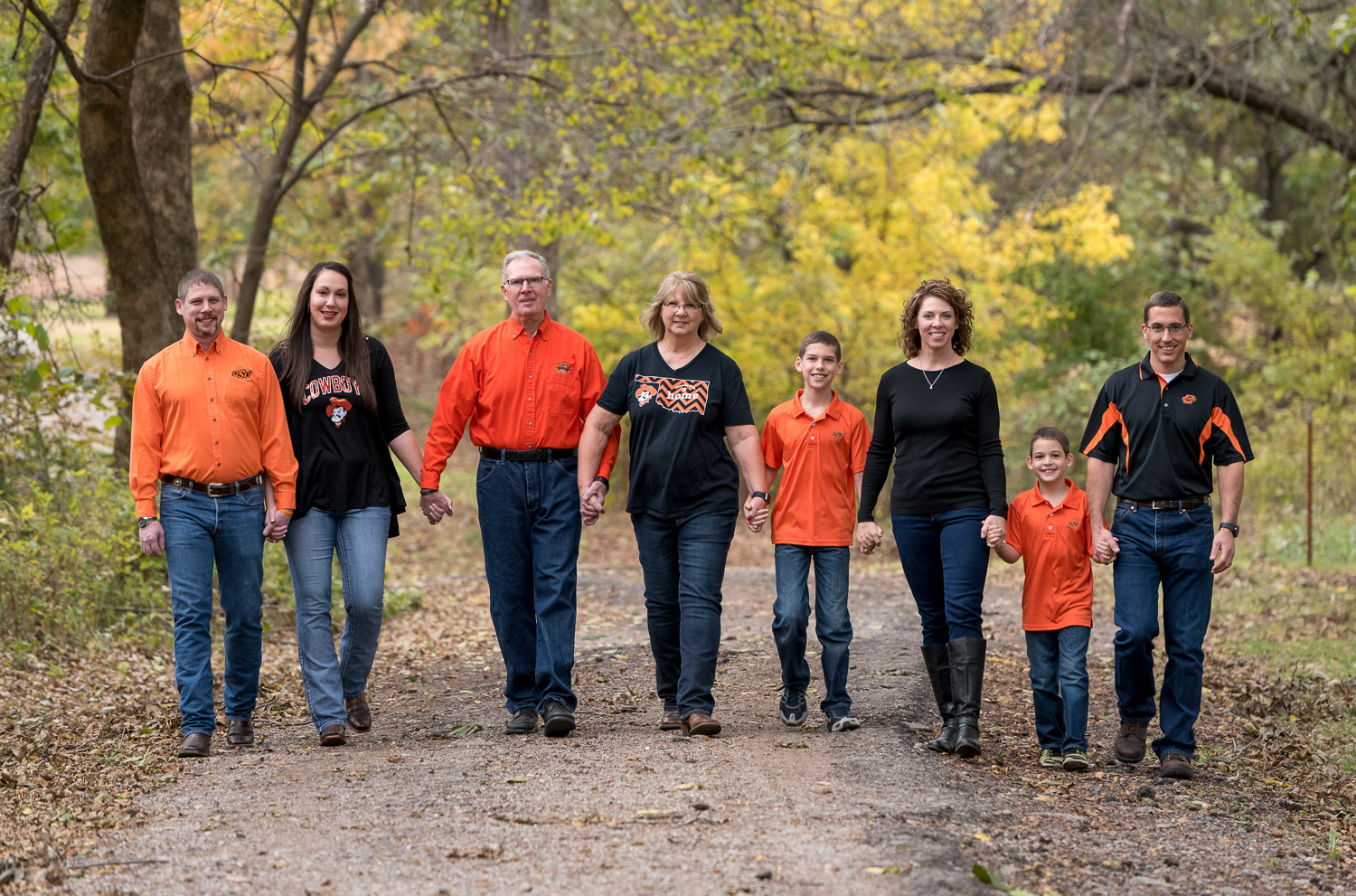 family walking on a pathway - 5 Crucial Mistakes You Need to Avoid When Photographing Clients