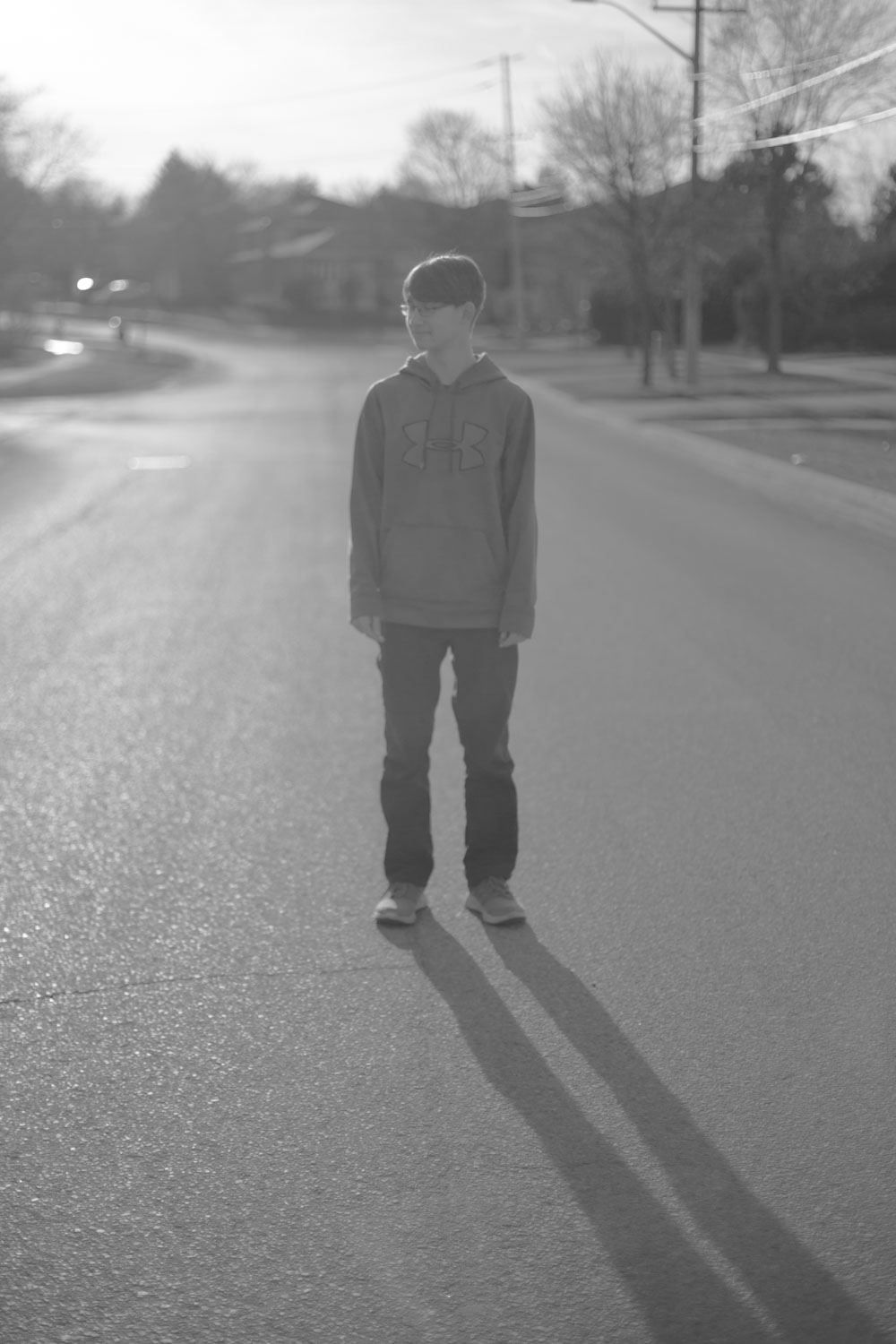 How to Use Low Graphic Style as a Compositional Tool - b/w of a boy in the road