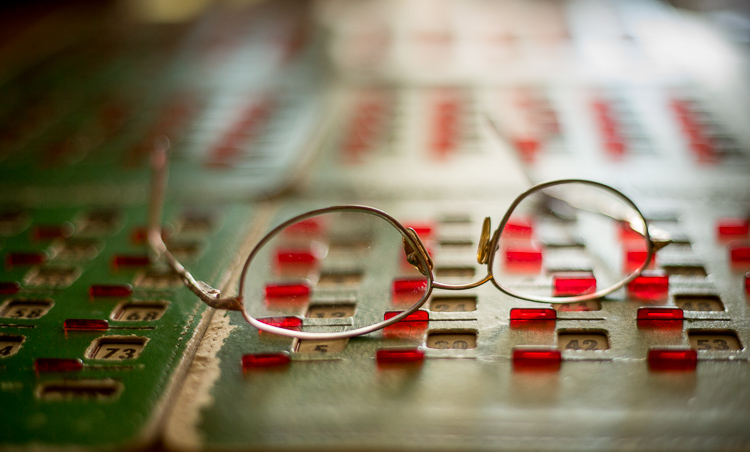 Image: Shallow depth of field brings focus to the glasses here. Make your subject stand out.