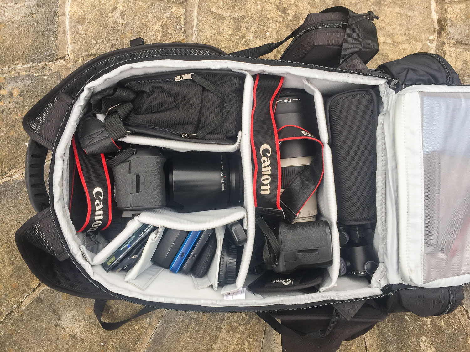 camera bag full of gear - The First 10 Things You Need to Buy After Your Camera for Travel Photography