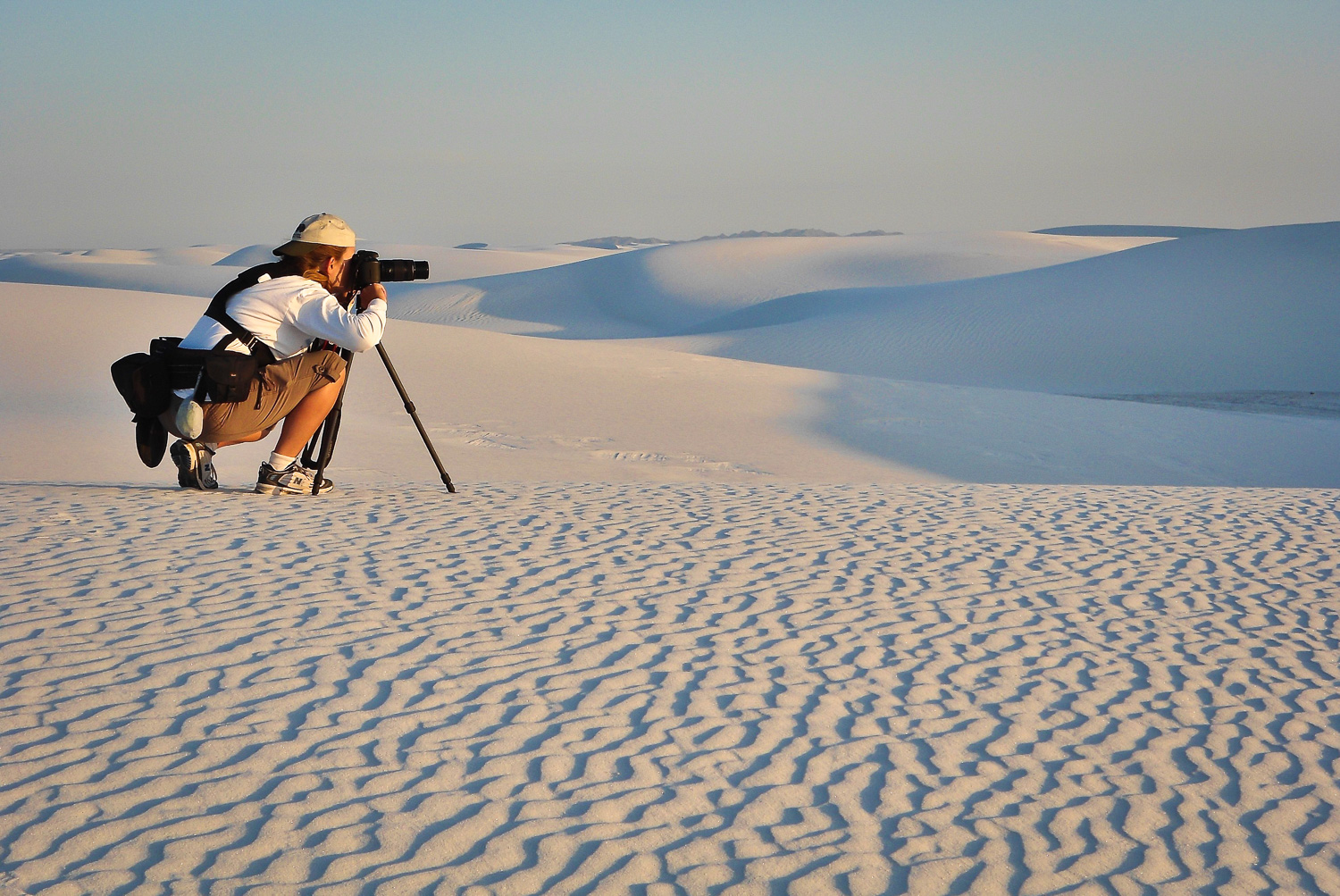 photographer on sand dunes - 10 Dos and Don'ts for Mastering Your Tripod