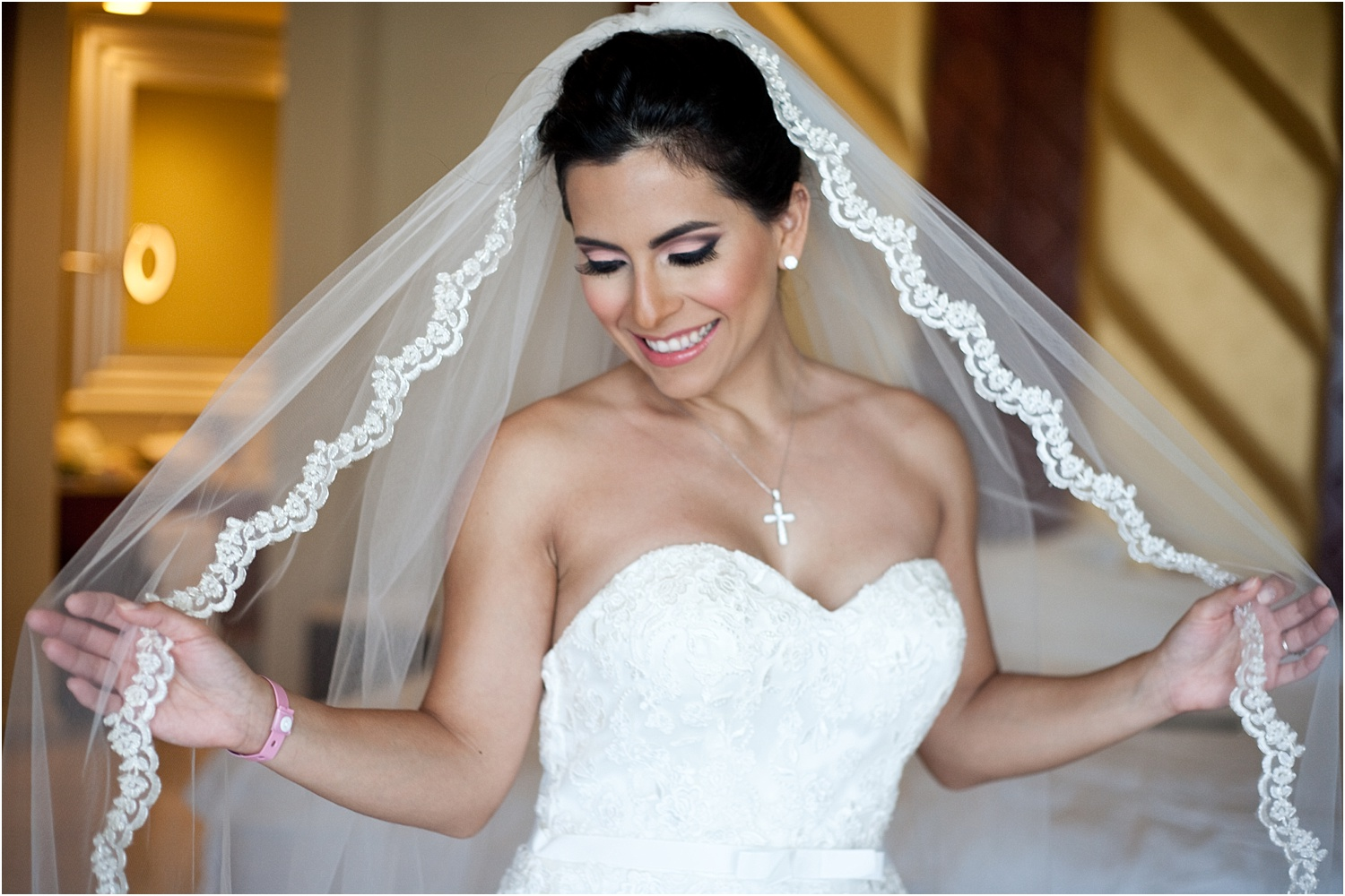 bride holding her veil - Tips for Better Bridal Portraits