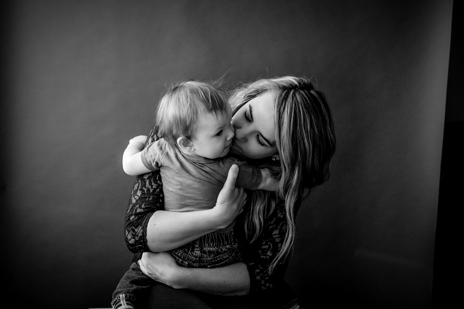 Mother hugging son portrait - 4 Tips for Helping People Feel Comfortable During Their Portrait Session