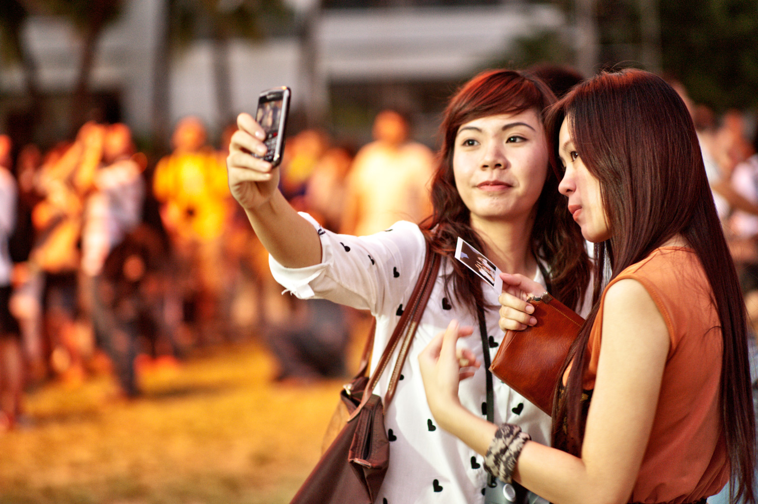 Photographer at an Outdoor Event taking a selfie - Pros and Cons of Upgrading from a Phone to a Real Camera