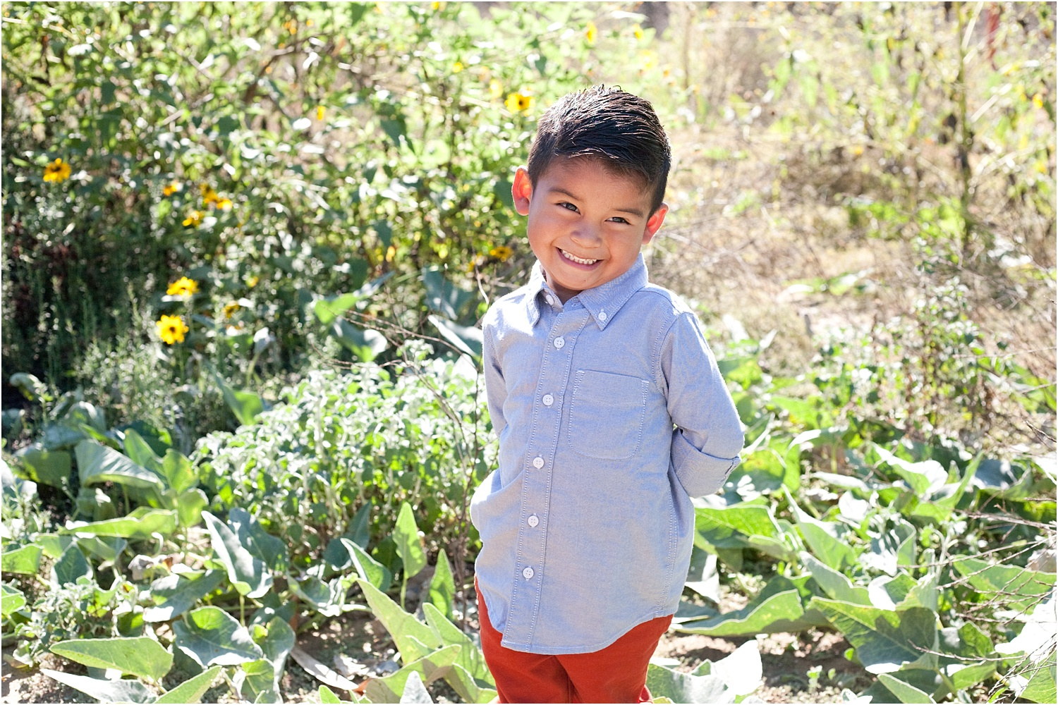 smiling boy in a field - How to do Portrait photography in Bright Midday Sun.