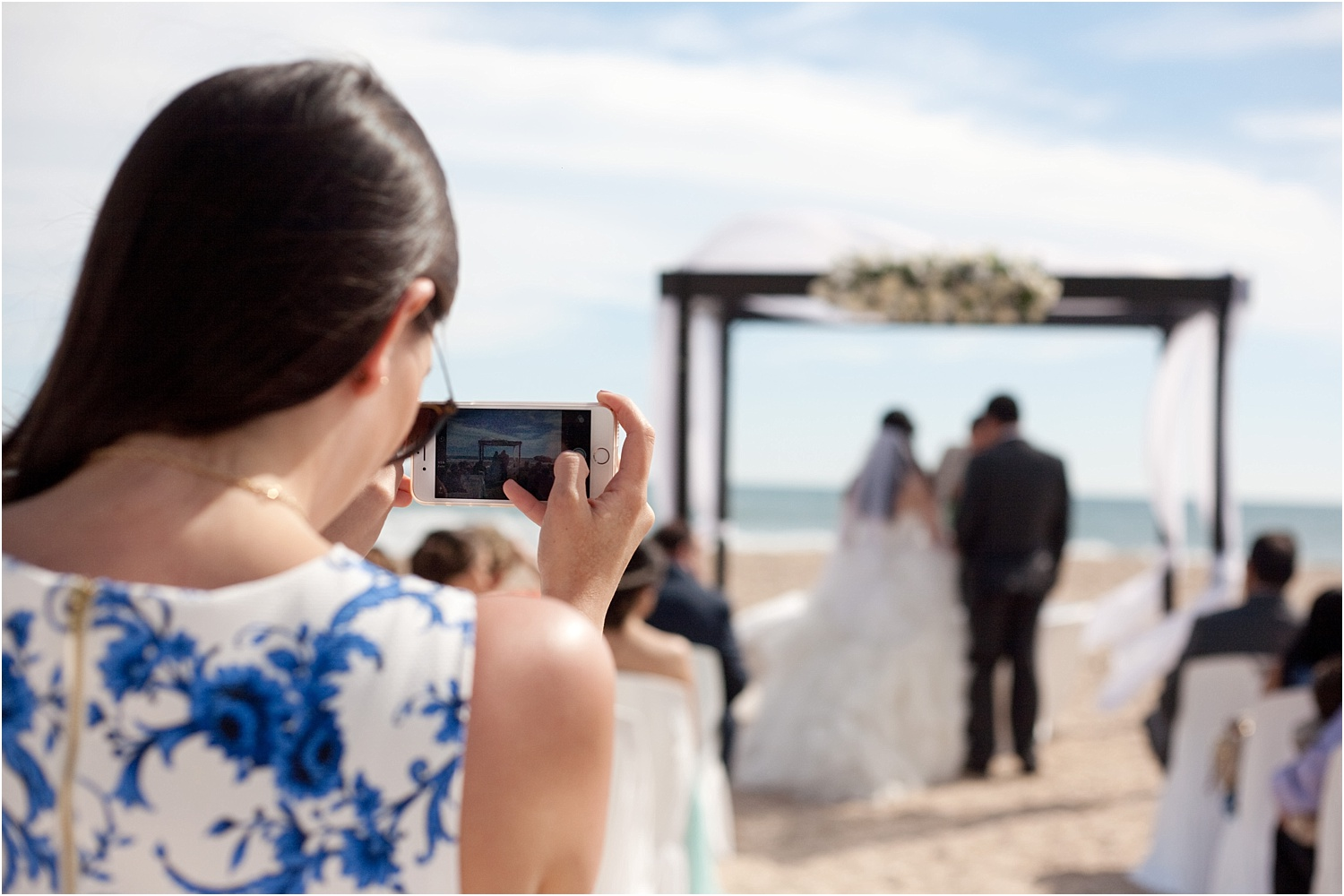 lady taking a photo at a wedding ceremony - wedding day photography