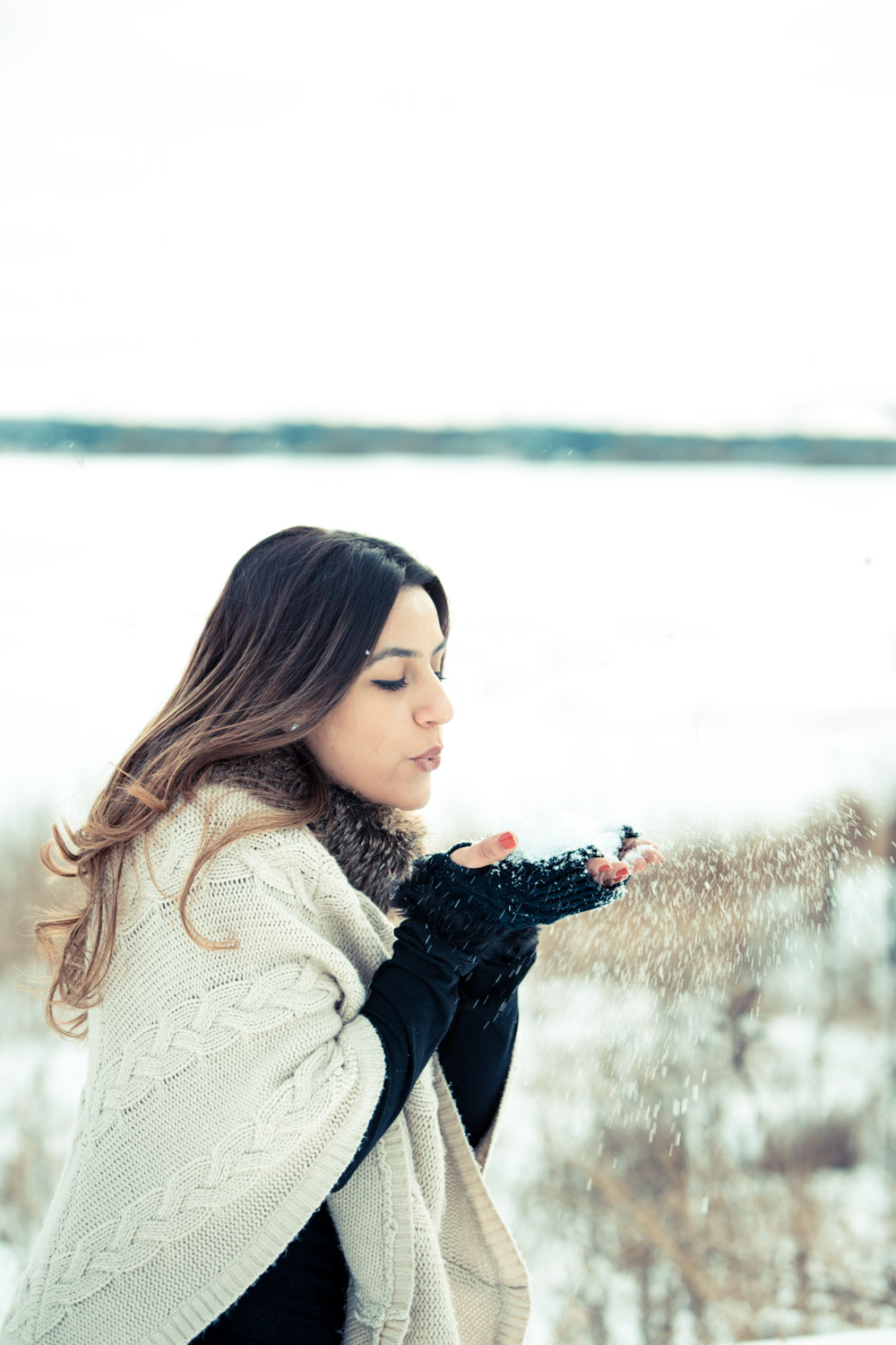 girl blowing snow off her hand - Tips for Preparing for a Portraits Session