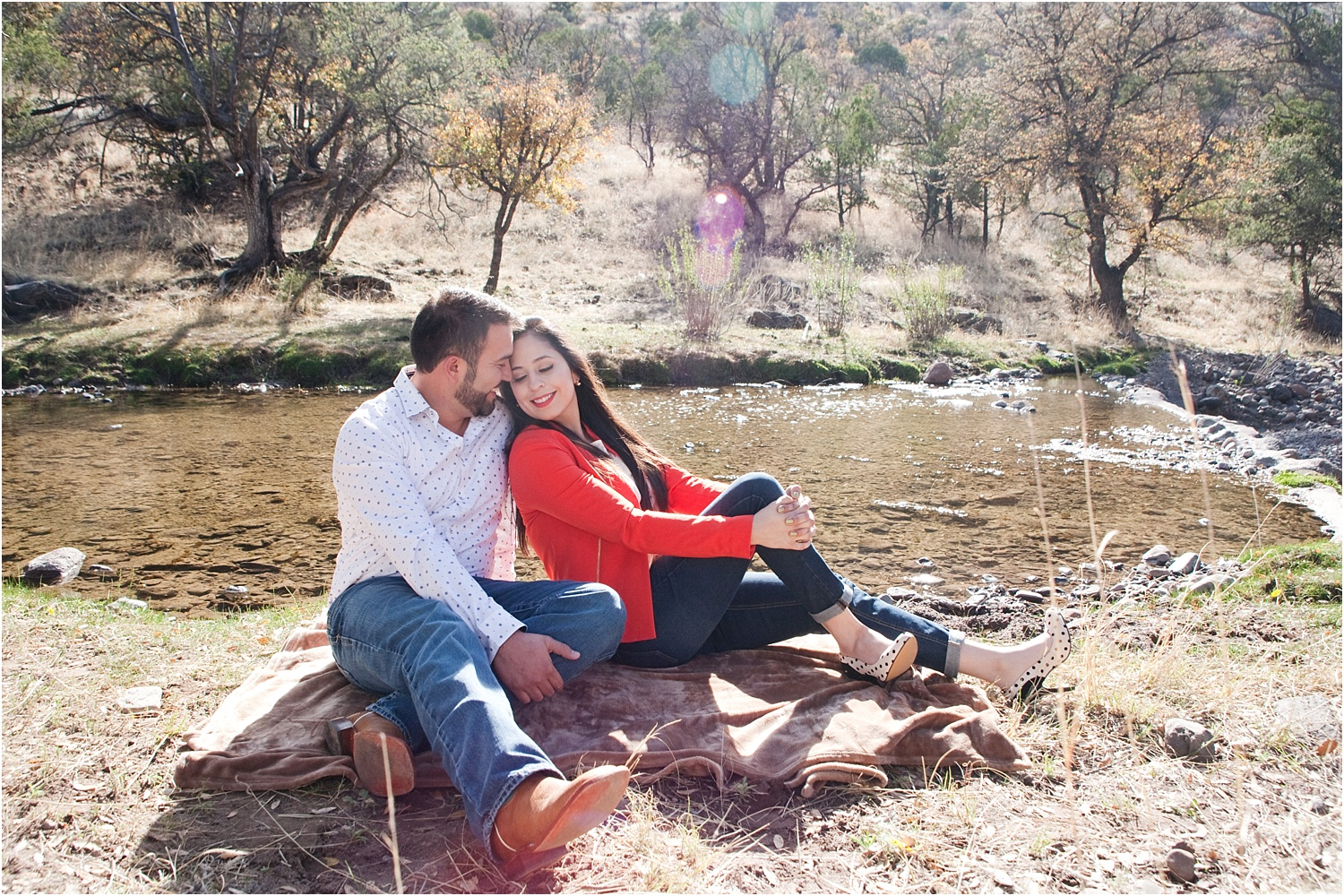 couple by a river - How to do Portrait Photography in Bright Midday Sun