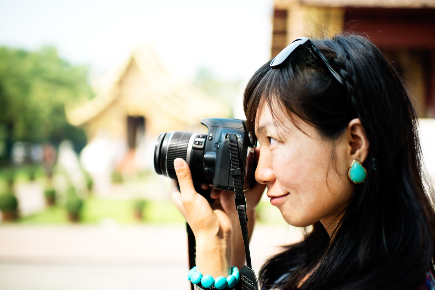 The Best Kind of People to Photograph While Traveling Chinese Woman Photographer © Kevin Landwer-Johan