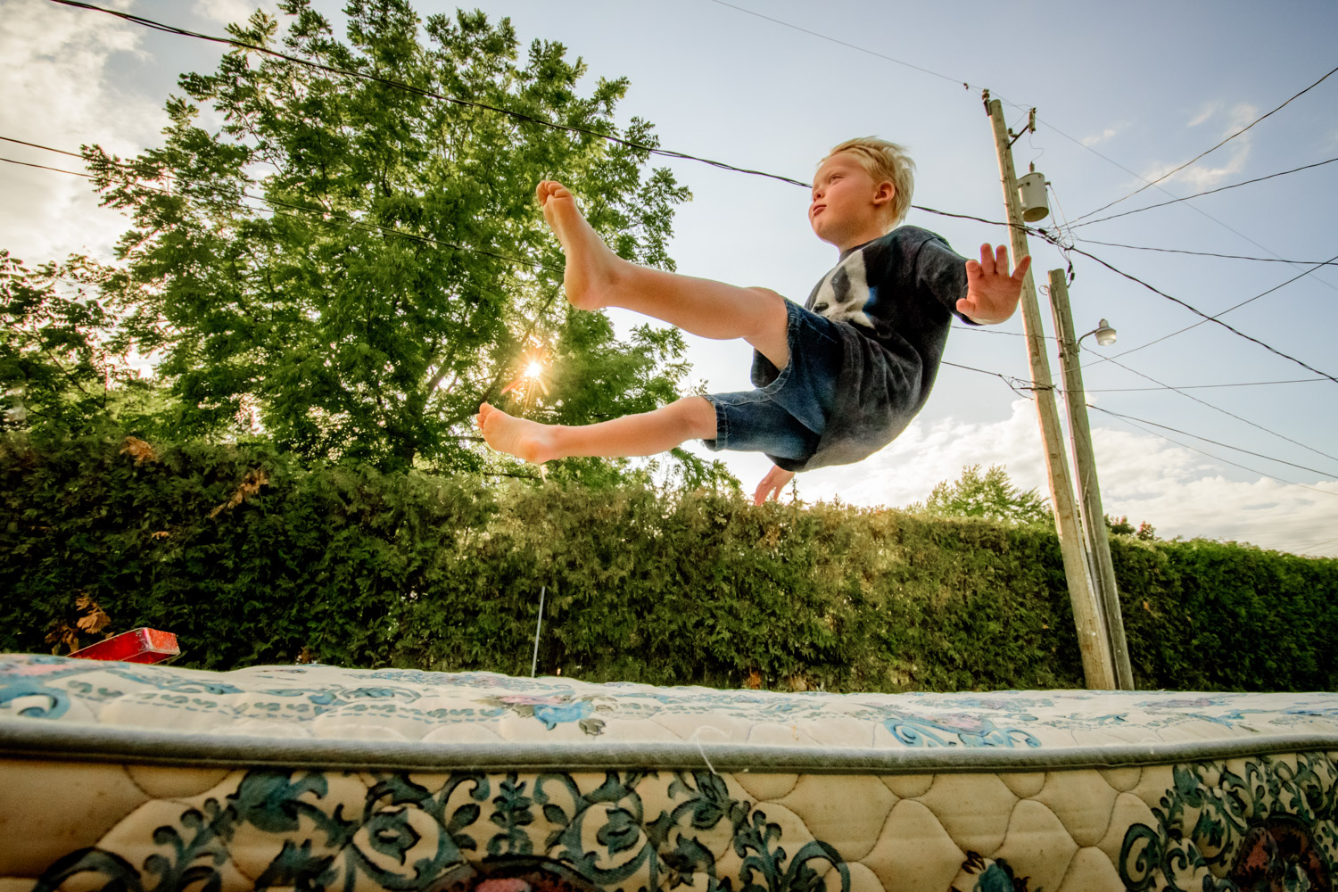 Image: Before it was hauled away, my kids turned this mattress into a trampoline. A low angle helped...