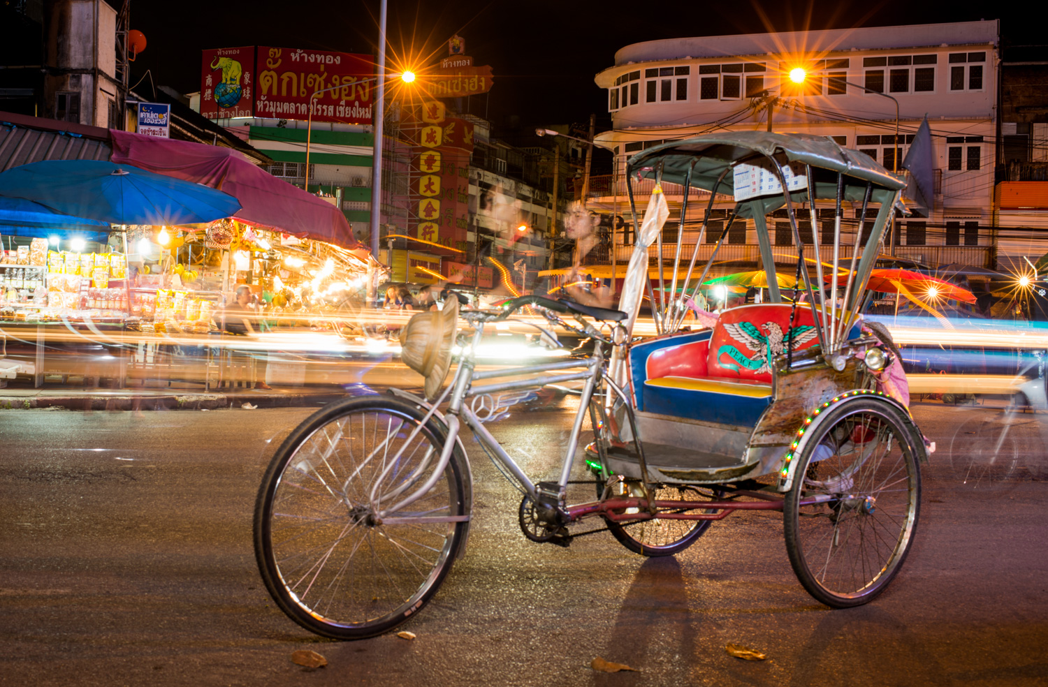 Tricycle Taxi Using a Slow Shutter Speed to a Create Sense of Motion