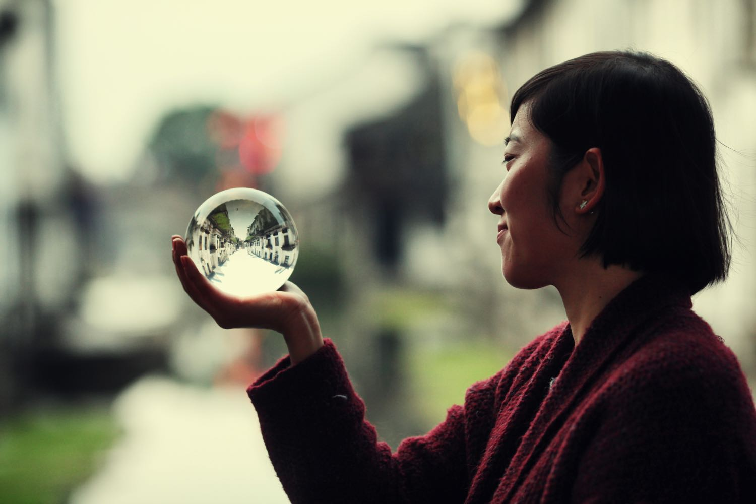 Image: In this photo, a portrait photo has been taken, but within the ball is a landscape image.