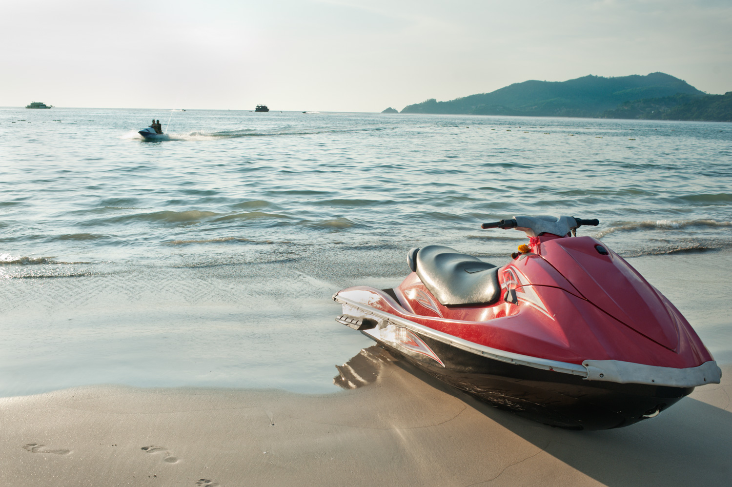 When should you obtain a model or property release? Jet ski on the beach